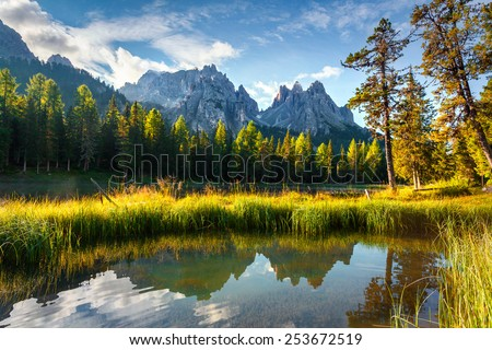 Colorful summer morning on the lake Antorno in National Park Tre Cime di Lavaredo. Cadini di Misurina Range, Dolomites, South Tyrol. Location Auronzo, Italy, Europe. - stock photo