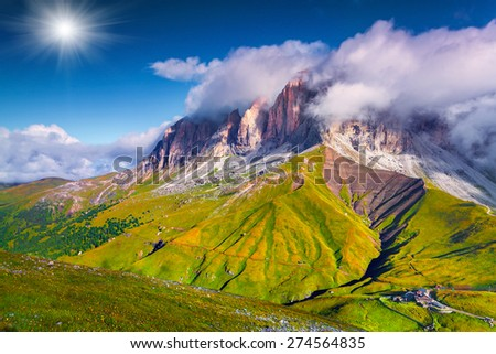 Colorful summer morning on the Sassolungo (Langkofel). View from the Sella pass. National Park Dolomites, South Tyrol. Location Ortisei, S. Cristina and Selva, Italy, Europe. - stock photo