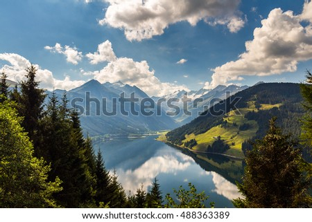 Colorful summer morning on the Speicher Durlassboden lake. View of Richterspitze mountain range in the Austrian Alps. Austria, Europe.