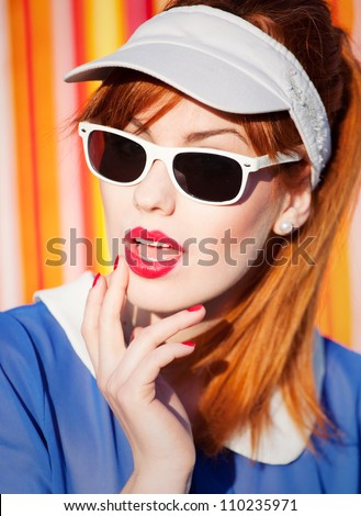 Colorful summer portrait of a woman with sunglasses
