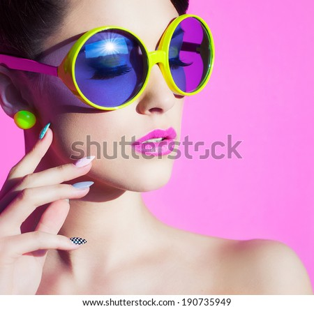 Colorful summer portrait of an attractive young woman with sunglasses  - stock photo
