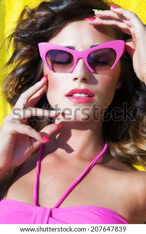 Colorful summer portrait of young attractive brunette woman wearing sunglasses, beauty and fashion concept - stock photo