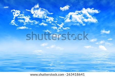 colorful summer sky with cumulus clouds and soft fog, view over water with waves - stock photo