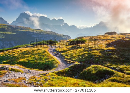 Colorful summer sunrise in the National Park Tre Cime di Lavaredo. Dolomites, South Tyrol. Location Auronzo, Italy, Europe. - stock photo
