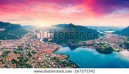 Colorful summer sunrise on the city and lake Lecco. Alps, Italy, Europe. - stock photo