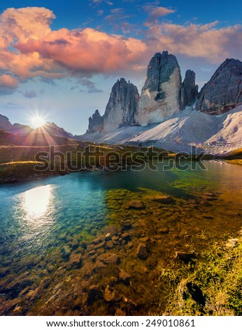 Colorful summer sunrise on the lake Rienza - Ursprung in National Park Tre Cime di Lavaredo. Dolomites, South Tyrol. Location Auronzo, Italy, Europe. - stock photo