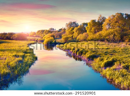 Colorful summer sunrise on the river. instagram toning. - stock photo