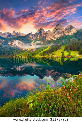 Colorful summer sunrise on the Vorderer Gosausee lake in the Austrian Alps. Austria, Europe. - stock photo