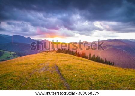 Colorful summer sunset in the Carpathian mountains. Cosarische ridge, Ukraine, Europe. - stock photo