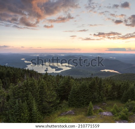 Colorful summer sunset view from the Blue Mountain Fire Tower in the Adirondacks Mountains of New York - stock photo
