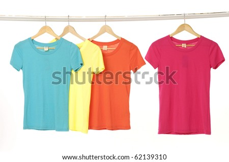 Colorful summer t-shirts on the hanger - stock photo