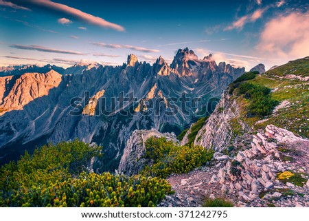 Colorful summer view of Gruppo del Cimonega mountain range in National Park Tre Cime di Lavaredo. Dolomites, South Tyrol. Location Auronzo, Italy, Europe. - stock photo