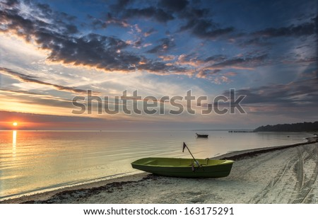 Colorful sunrise at sandy beach of the Baltic Sea, Latvia, Europe - stock photo