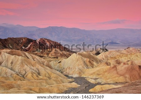 Colorful sunrise of Zabriskie Point, Death Valley, California, USA - stock photo