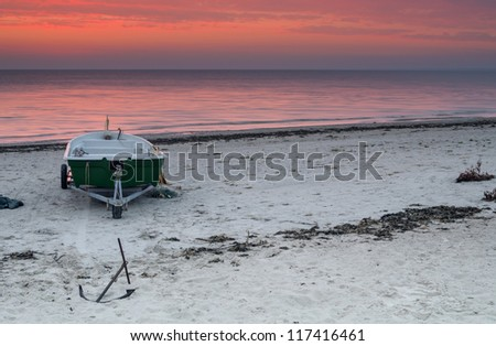 Colorful sunrise on a sandy beach of the Baltic Sea, Latvia, Europe - stock photo