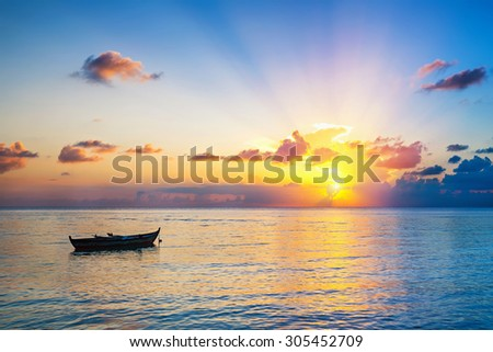 Colorful sunrise over ocean on Maldives - stock photo
