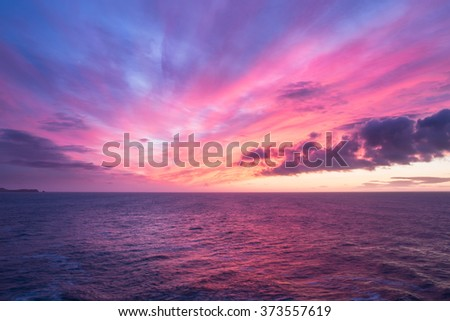 Colorful sunrise over the ocean, New Zealand - stock photo