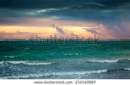 Colorful sunrise sky over Atlantic ocean. Dominican republic, Punta Cana. Toned photo with contrast filter effect - stock photo