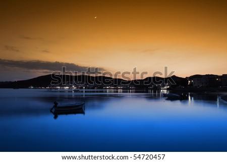 Colorful sunset at Milos island, Greece - stock photo