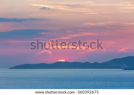 Colorful sunset at Pattaya bay ,Chonburi, Thailand from above with magenta and blue tint. - stock photo