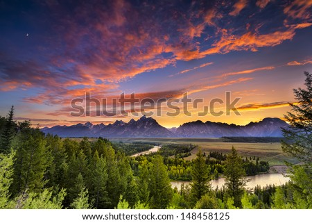 Colorful sunset at Snake River Overlook in Grand Teton National Park, WY - stock photo