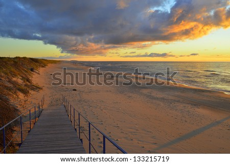 Colorful sunset at the Curonian Spit, Baltic Sea, Lithuania, Europe - stock photo