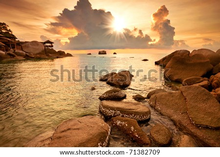 Colorful sunset at the rocks - stock photo