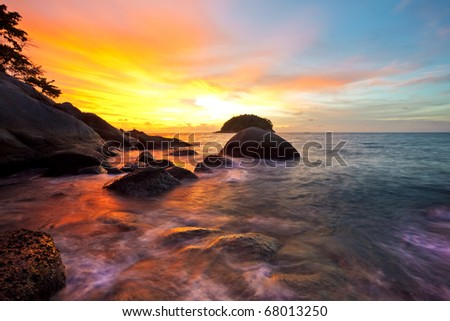Colorful sunset at the sand tropical beach - stock photo