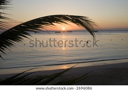 Colorful sunset from a beach in Jamaica. - stock photo