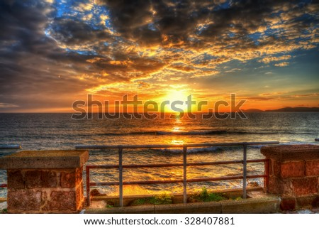 colorful sunset in Alghero seafront, Italy - stock photo
