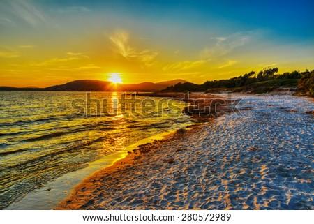colorful sunset in Alghero shoreline, Sardinia - stock photo