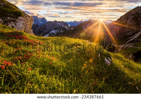 Colorful sunset in Julian Alps - stock photo