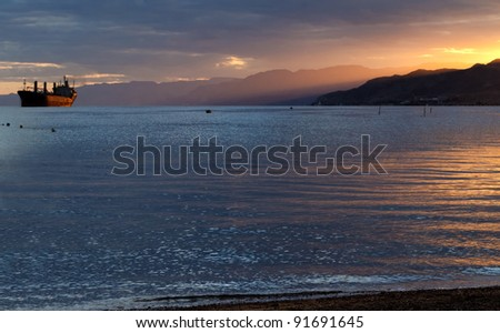Colorful sunset in the gulf of Aqaba near Eilat - popular resort and recreation city in Israel - stock photo