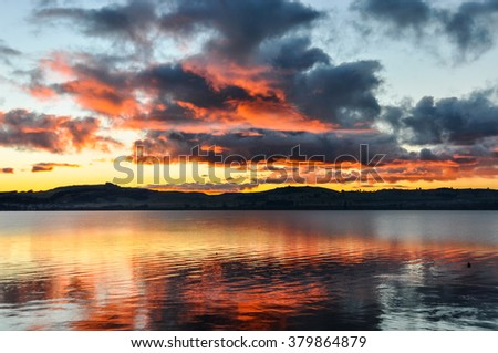Colorful sunset in the majestic Lake Taupo in the North Island of New Zealand - stock photo