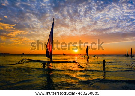 colorful sunset in the Philippines tropical island of Boracay famous for the white sandy beach of fine and its nightlife