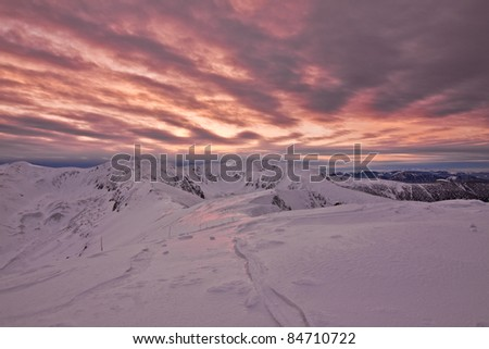Colorful sunset in winter from the top of the Tatra mountains - stock photo