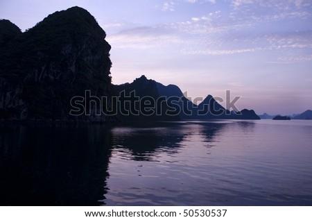 Colorful sunset on Ha long Bay, Vietnam - stock photo
