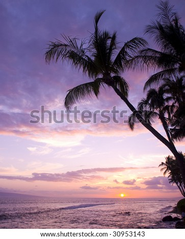 Colorful sunset on Kaanapali Beach in Maui. - stock photo