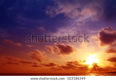 Colorful sunset on the beach. - stock photo