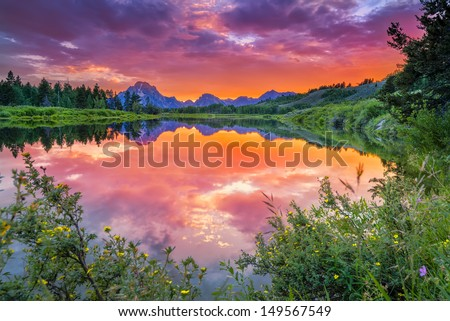 Colorful sunset on the Oxbow Bend of the Snake River in Wyoming - stock photo
