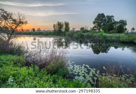 Colorful sunset on the river. The Ukraine - stock photo