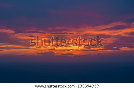 colorful sunset on the sea with beautiful clouds - stock photo