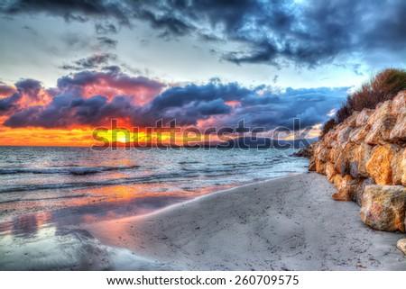 Colorful sunset over Alghero shoreline, Sardinia - stock photo