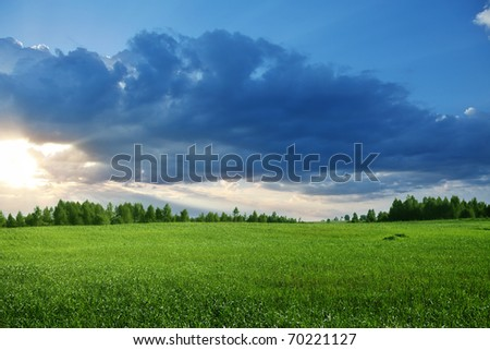 Colorful sunset over field. - stock photo