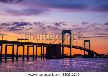 Colorful sunset over Long Island Sound and Throgs Neck Bridge in New York City - stock photo