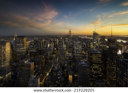 Colorful sunset over manhattan skyline, New york - stock photo