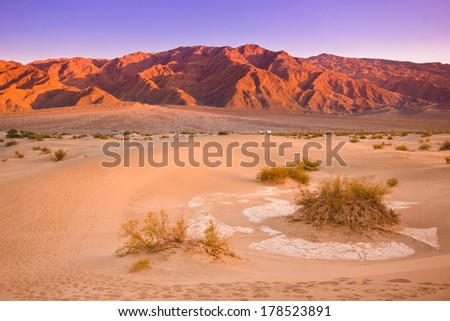 Colorful sunset over Mesquite dunes of Death Valley California - stock photo