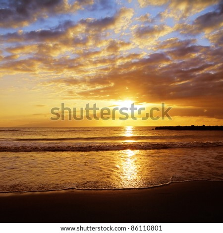 Colorful sunset over ocean. - stock photo