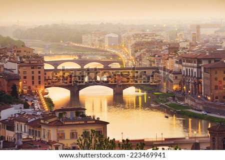 Colorful sunset over Ponte Vecchio on Arno River, Florence, Italy - stock photo