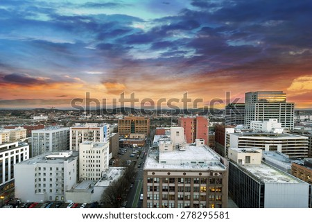 Colorful Sunset Over Portland Oregon Downtown Cityscape with Mt Hood in the Distant - stock photo
